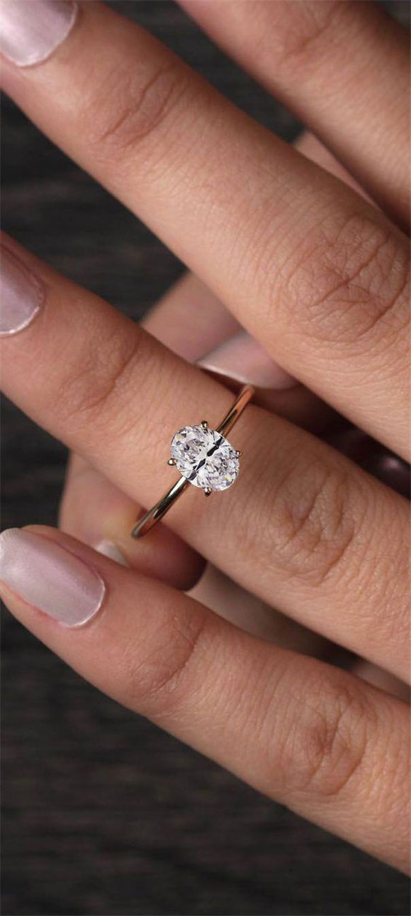 Simple Solitaire Engagement Ring in Rose Gold