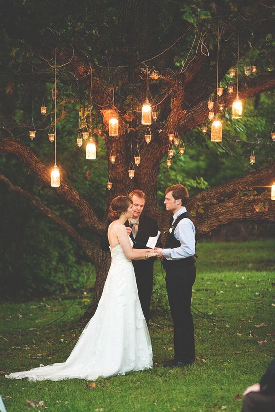 Romantic Mason jar lighting illuminates this wedding